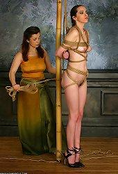 Two lesbian playing with bondage