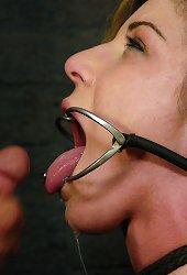 Beautiful girl wearing a dental gag sucking cock