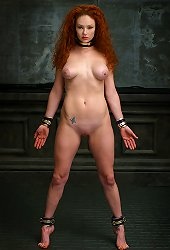 Sweet red haired slave with huge breast ready to submit to her master