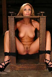 Blond girl dressed in sexy latex gets tied to a bench for deep fucking