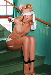 Pin-Up style topless cutie blindfolded and bondaged at house ladder