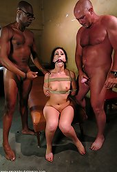 Submissive girl gets tied with her legs kept apart and fucked by two..