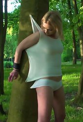 Blonde girl gets her clothes nailed to a tree and hands tied up