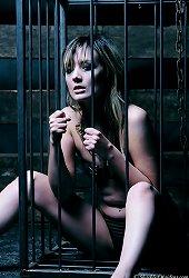Hottie caged in bdsm dungeon