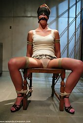Pretty girl gets interrogated in a dark holding cell