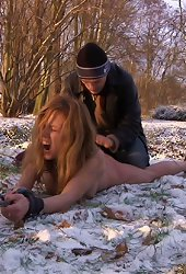 Rough bondage sex action on cold snow